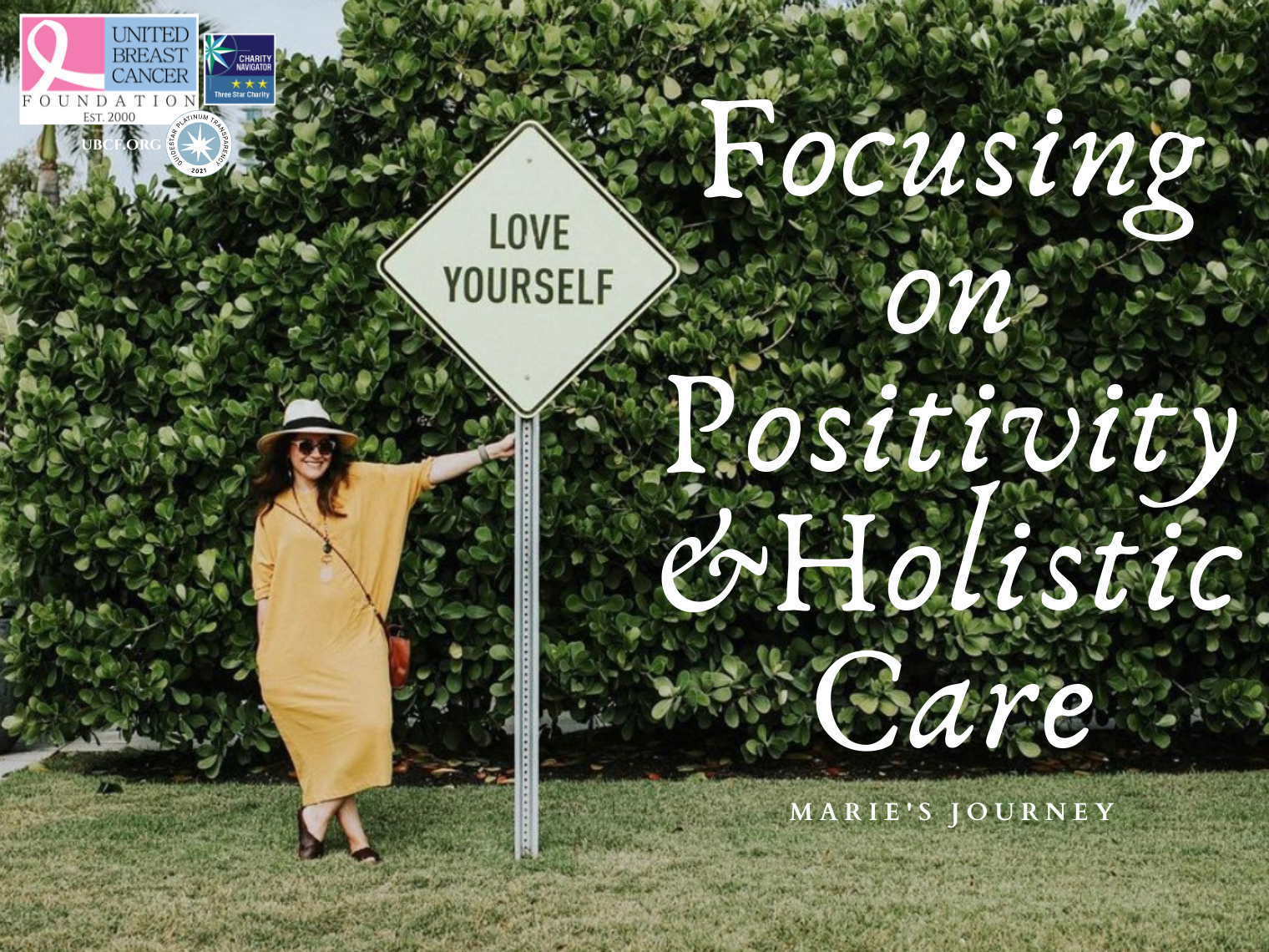 This image features Marie standing in front of a 'love yourself' sign. She is focusing on positivity and holistic care.